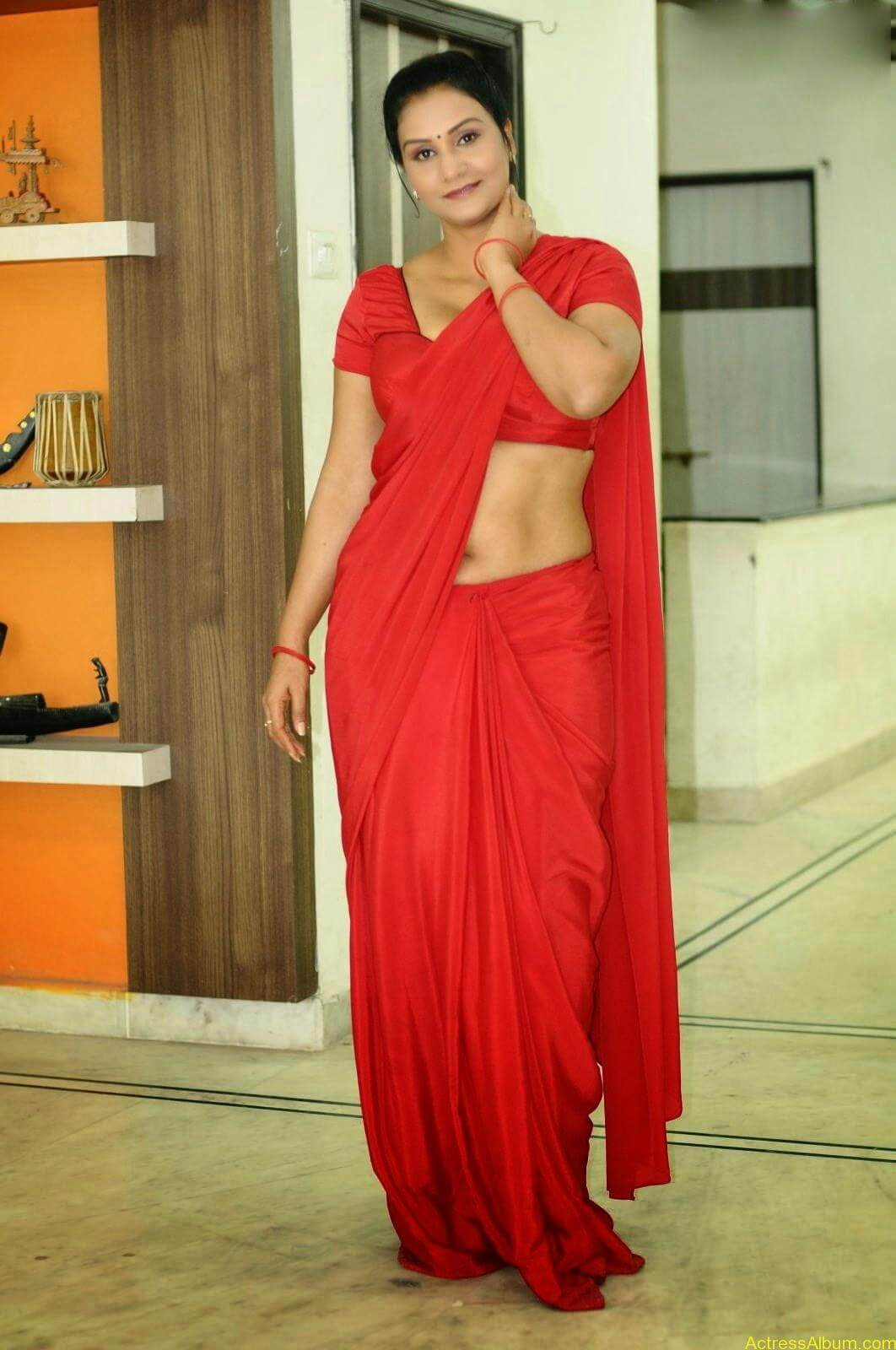 ACTRESS APOORVA VERY HOT IN RED SAREE PHOTO COLLECTION 4