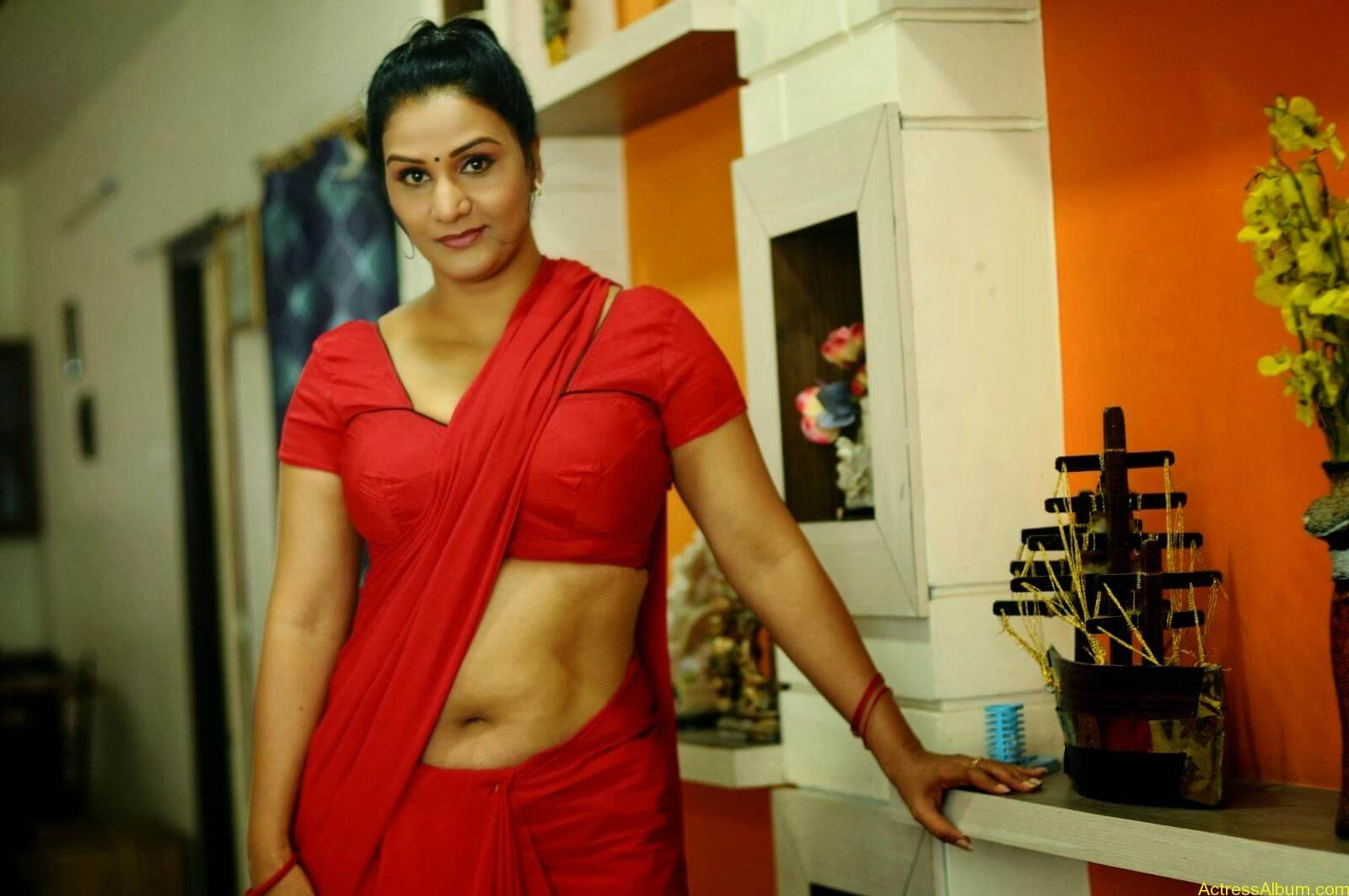 ACTRESS APOORVA VERY HOT IN RED SAREE PHOTO COLLECTION 5