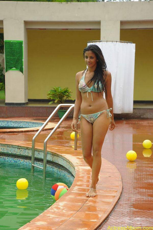Actress Rithika navel show in Bikini dress13