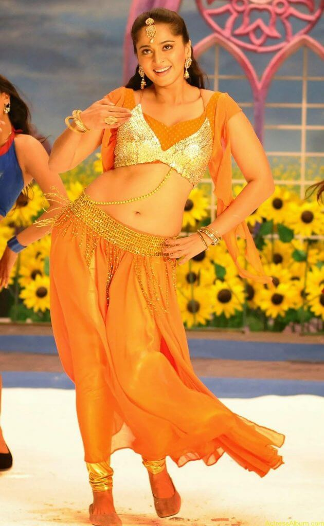 Anushka Shetty Hot In Gold & Sexy Navel Show in Dance Scene Stills