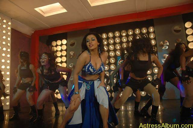 Asha Saini Bending Down to show Huge Cleavage in Item Song in Blue Dress10