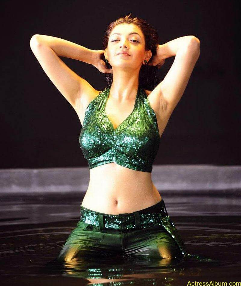 Kajal Agarwal Hot Navel Show In Green Wet Dress Pictures