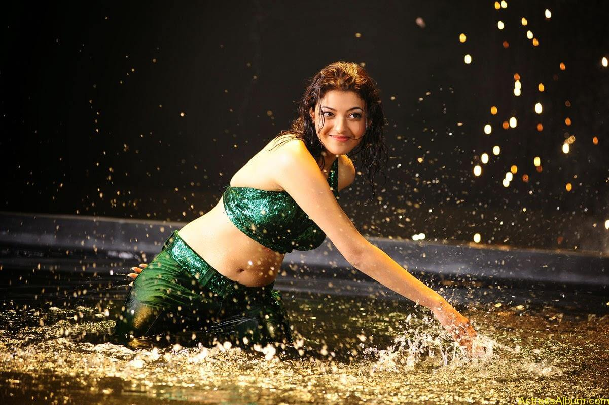 Kajal Agarwal Hot Navel Show In Green Wet Dress Pictures4