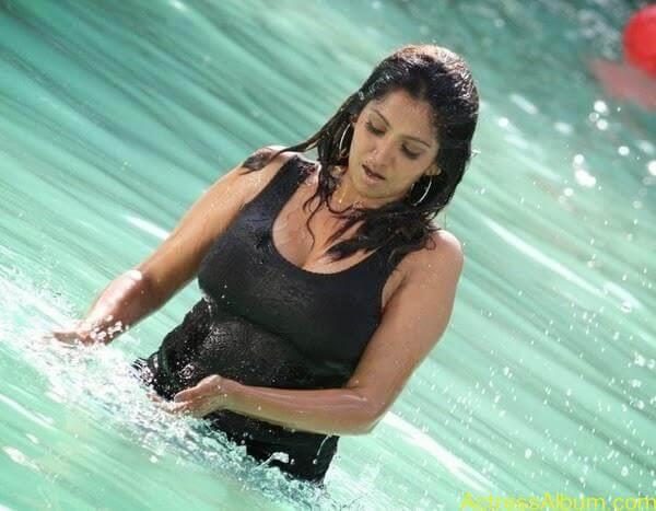 Masala Actress Bhuvaneswari Aunty In Wet Black Dress Photos 4