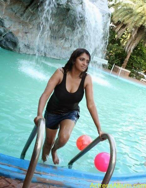 Masala Actress Bhuvaneswari Aunty In Wet Black Dress Photos