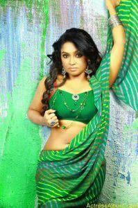 Mithra Kurian Hot Navel Pics In Green Saree