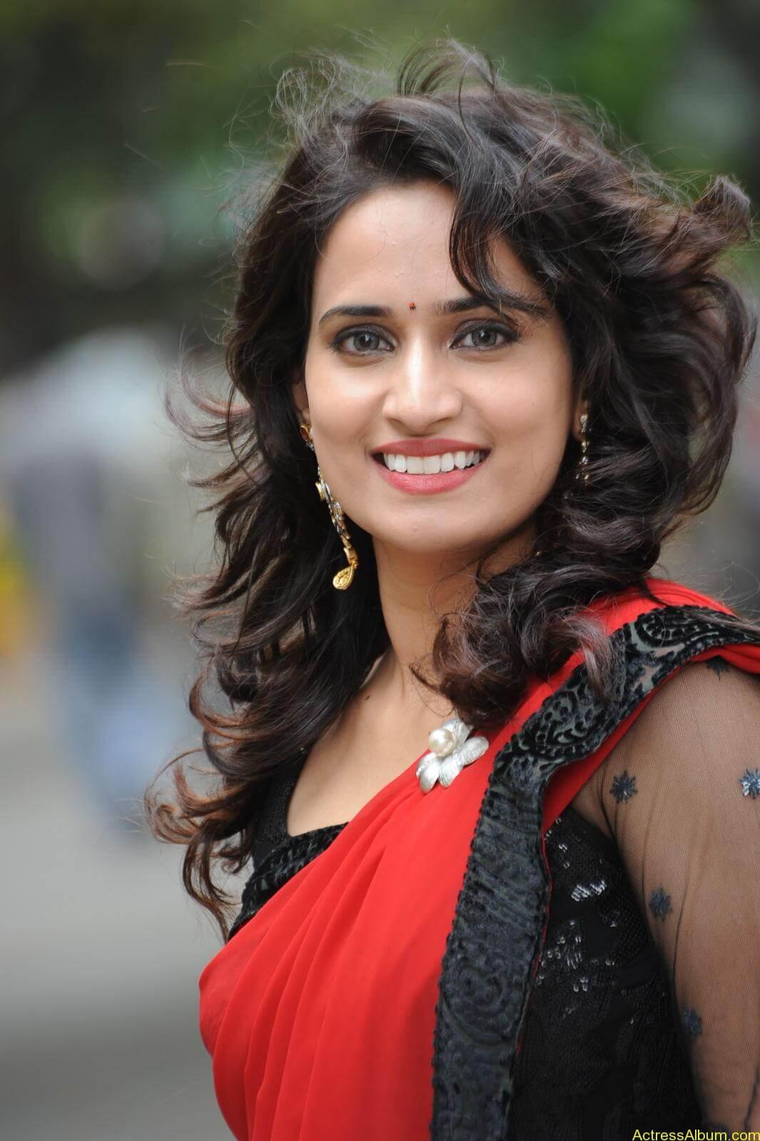 Chinmayi Ghatrazu Hot stills in Red colour Saree (1)