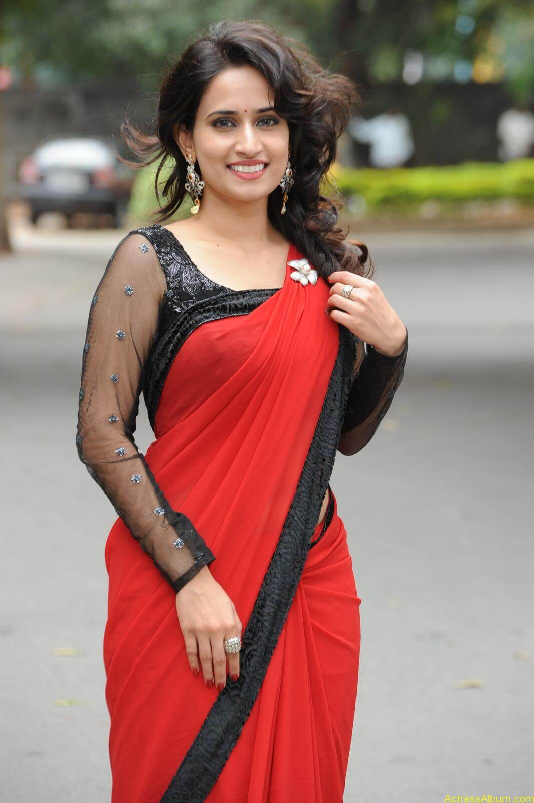 Chinmayi Ghatrazu Hot stills in Red colour Saree (10)