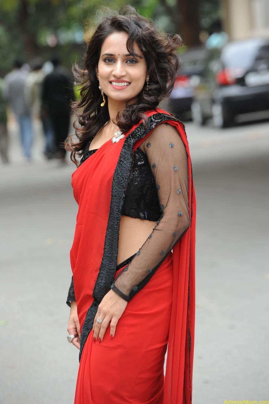 Chinmayi Ghatrazu Hot stills in Red colour Saree (11)