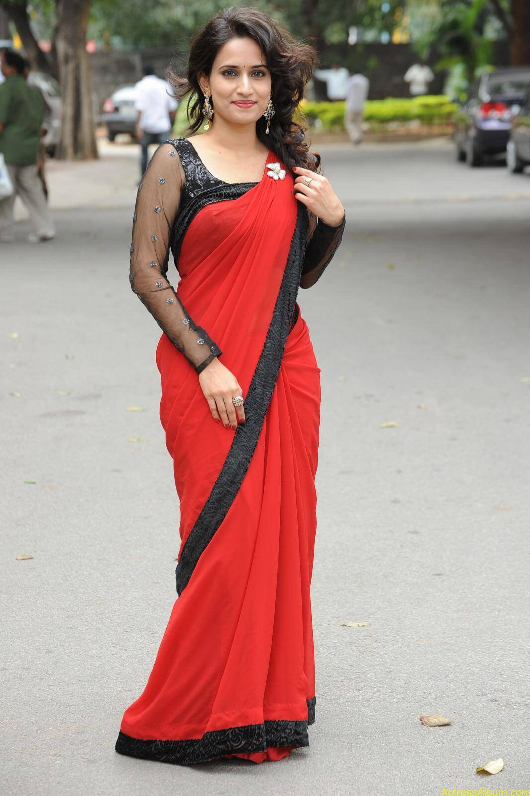 Chinmayi Ghatrazu Hot stills in Red colour Saree (12)