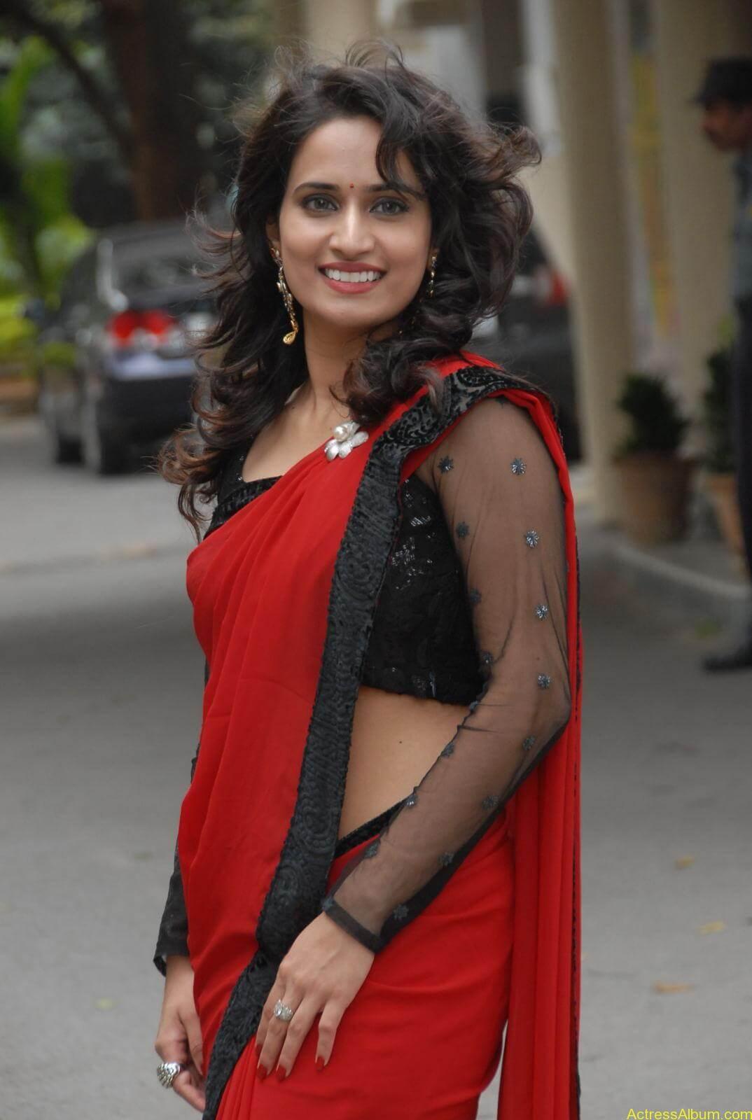 Chinmayi Ghatrazu Hot stills in Red colour Saree (2)