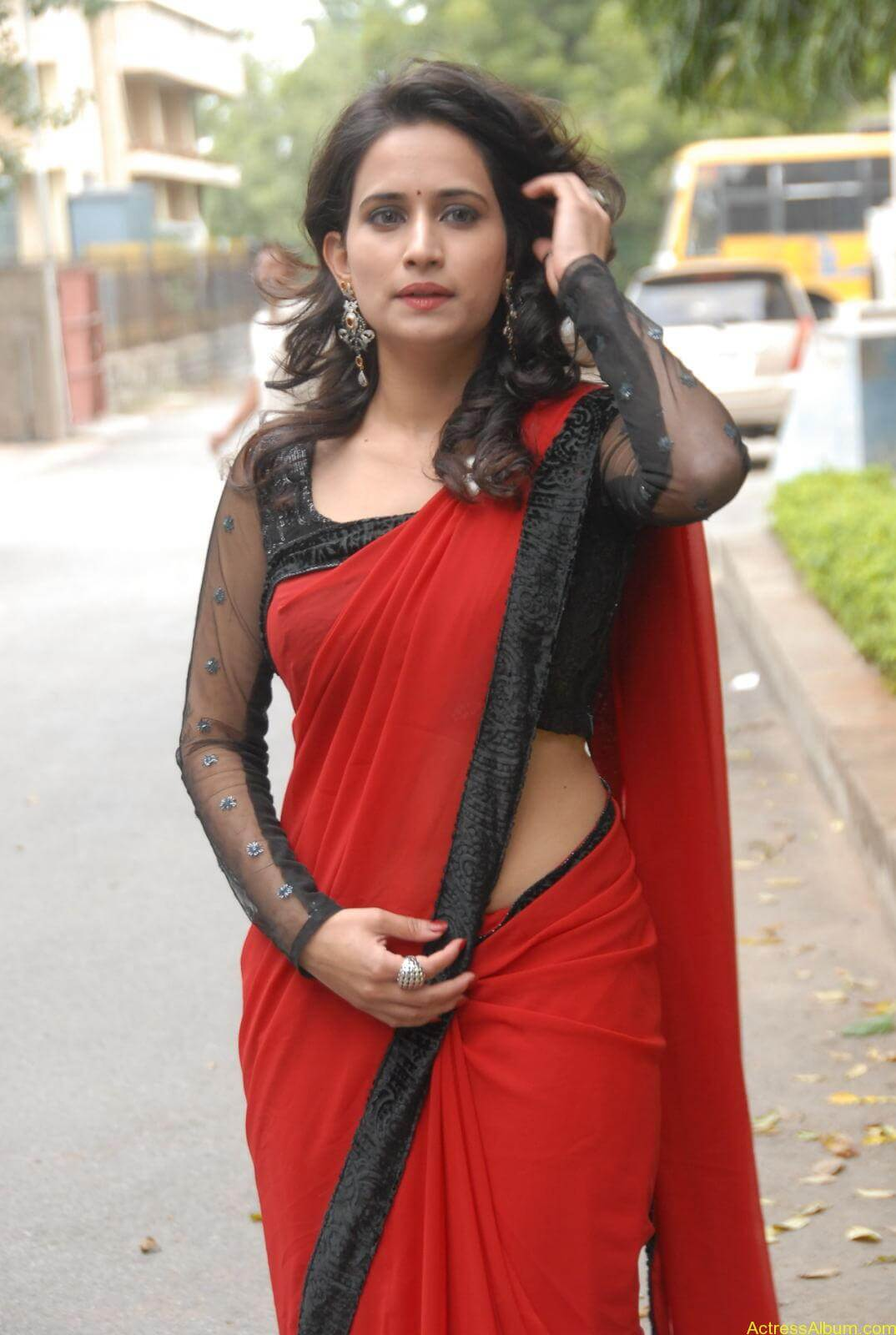 Chinmayi Ghatrazu Hot stills in Red colour Saree (5)