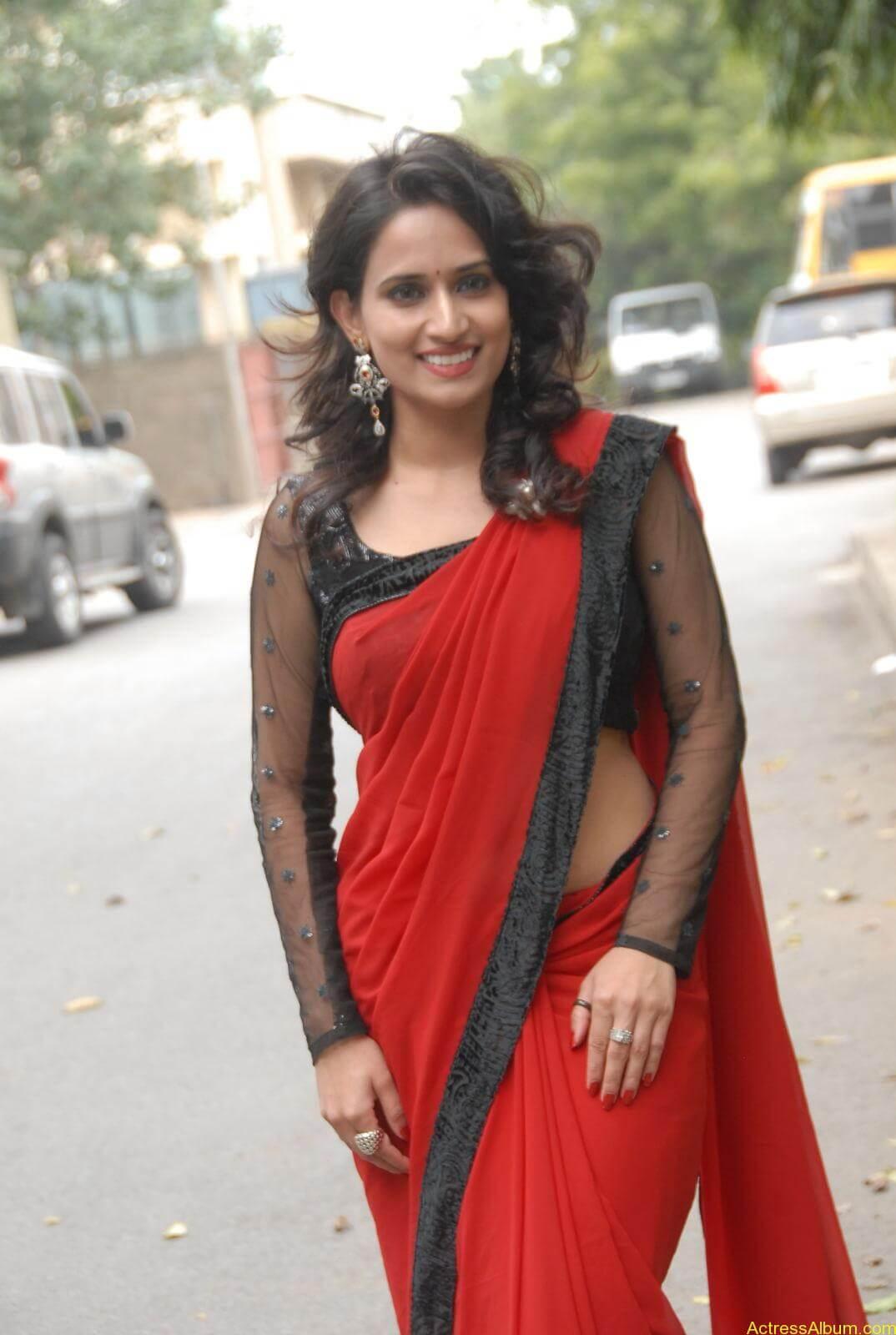 Chinmayi Ghatrazu Hot stills in Red colour Saree (8)