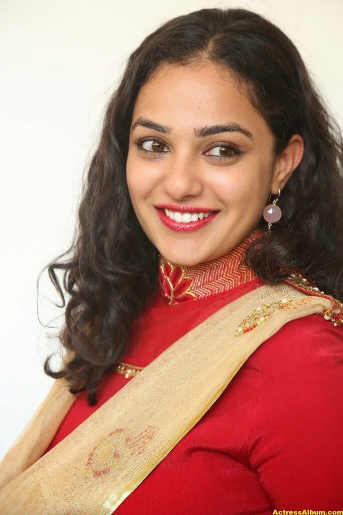 Nithya Menon Latest Stills In Red Dress HQ 1