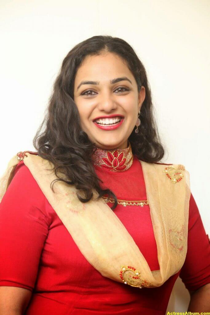 Nithya Menon Latest Stills In Red Dress HQ 7