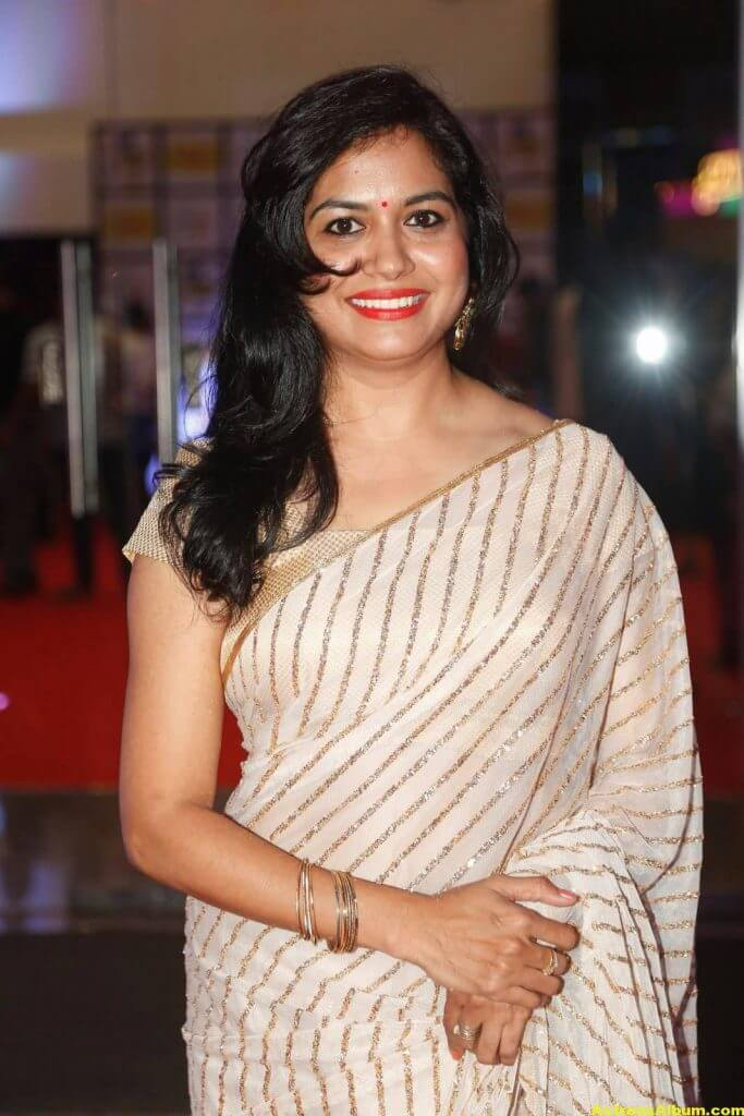 Singer Sunitha Latest Stills In White Saree 1