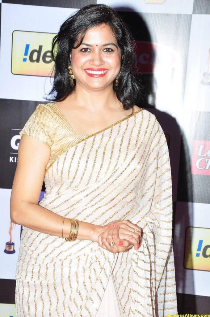 Singer Sunitha Latest Stills In White Saree 4