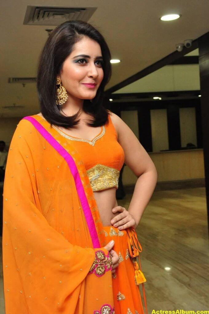 Rashi Khanna Latest Hot Stills In Orange Dress (2)