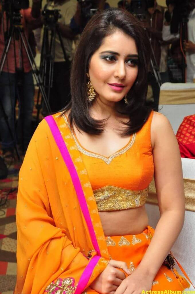 Rashi Khanna Latest Hot Stills In Orange Dress (8)