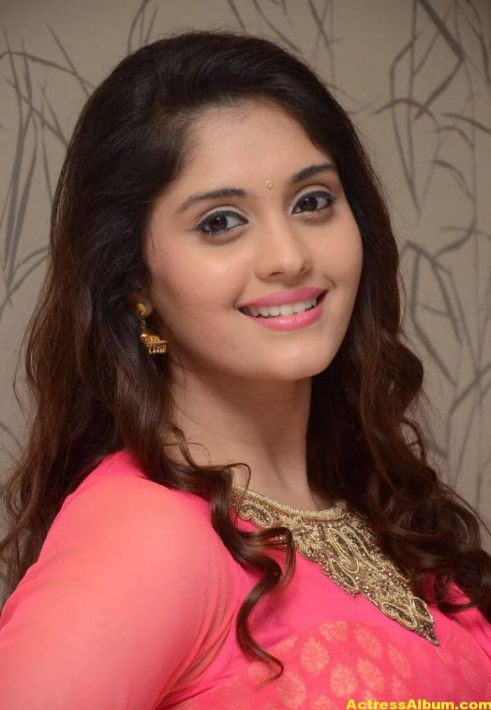 Surabhi Stills In Orange Dress At Movie Success Meet (1)