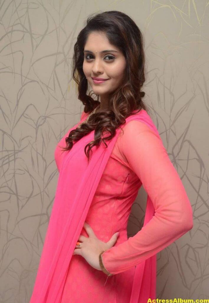 Surabhi Stills In Orange Dress At Movie Success Meet (2)