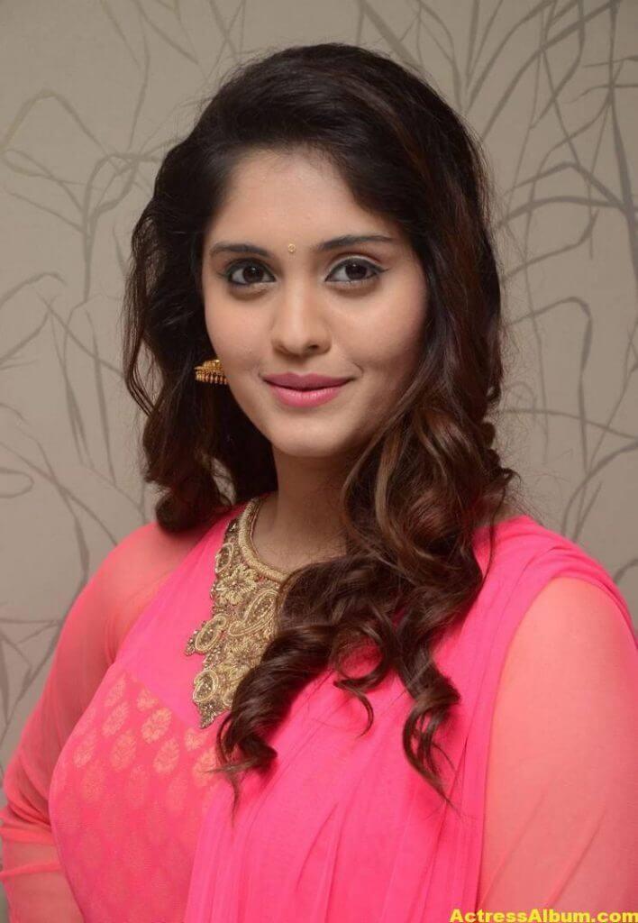 Surabhi Stills In Orange Dress At Movie Success Meet (5)