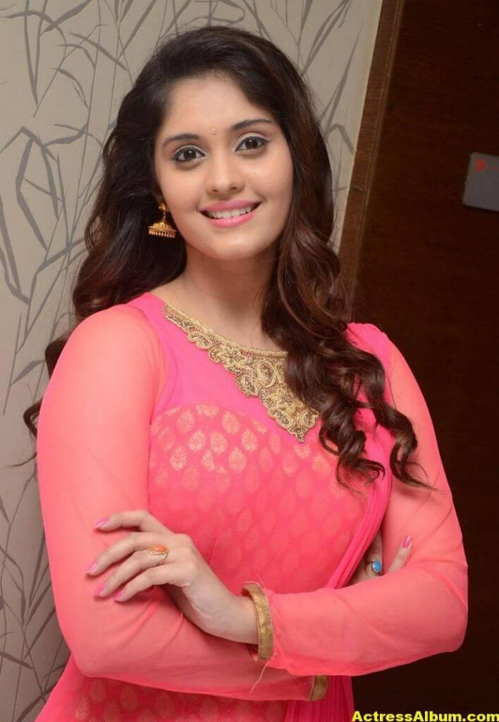 Surabhi Stills In Orange Dress At Movie Success Meet (6)