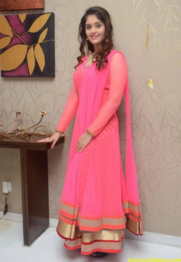 Surabhi Stills In Orange Dress At Movie Success Meet (7)