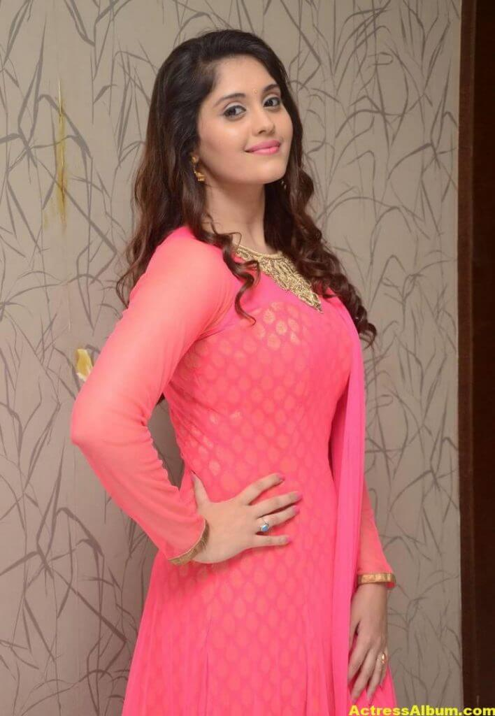 Surabhi Stills In Orange Dress At Movie Success Meet (8)