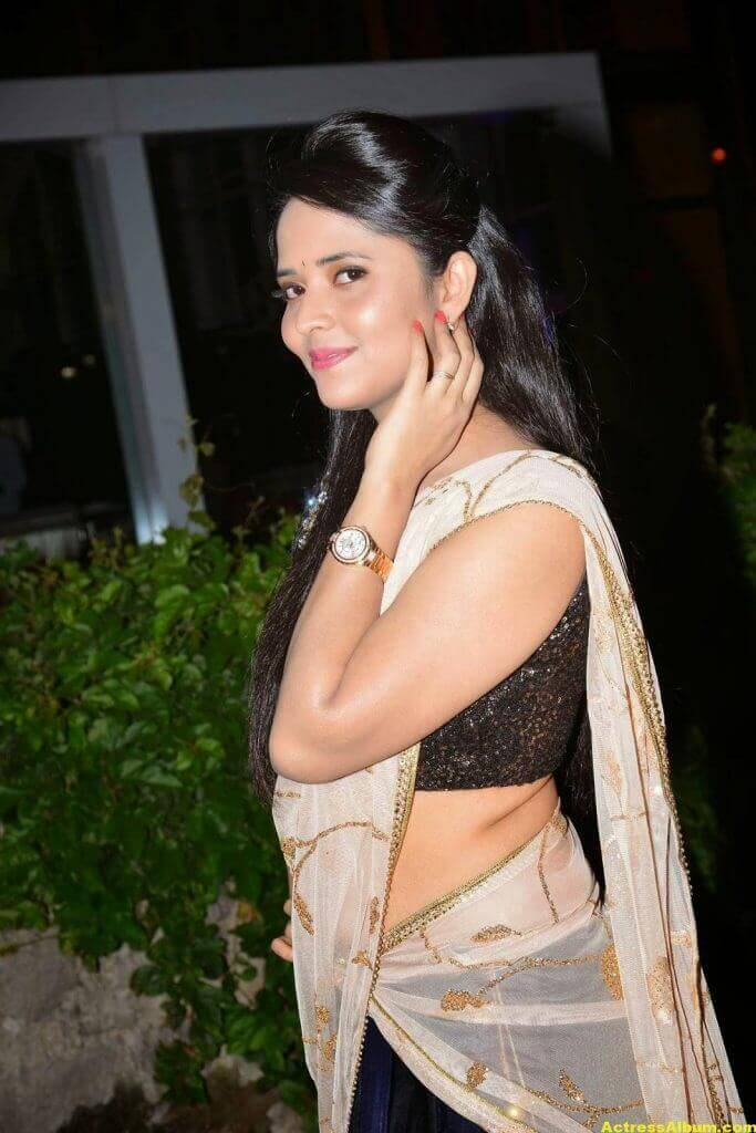 Anasuya Hip Show Photos In Black Half Saree 4