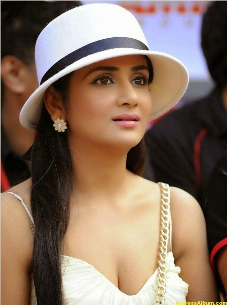 Parul Yadav Hot Stills With Cap In White Dress 4