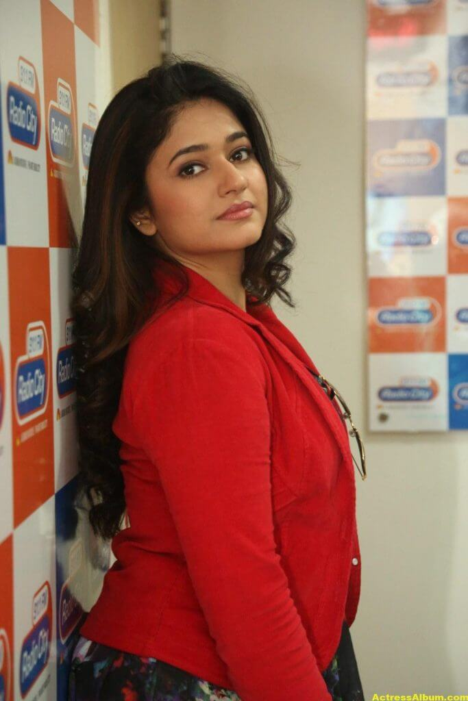 Poonam Bajwa Photos At Radio City In Red Dress 3