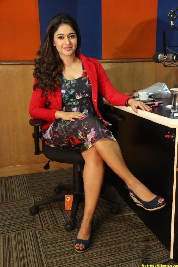 Poonam Bajwa Photos At Radio City In Red Dress 7