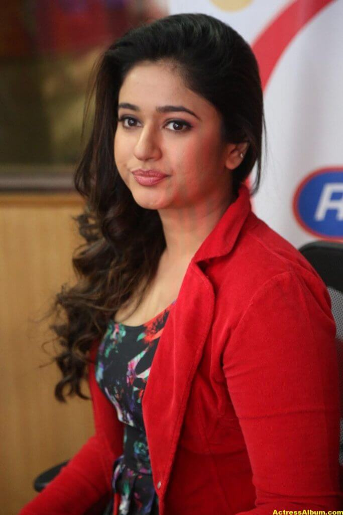 Poonam Bajwa Photos At Radio City In Red Dress 8