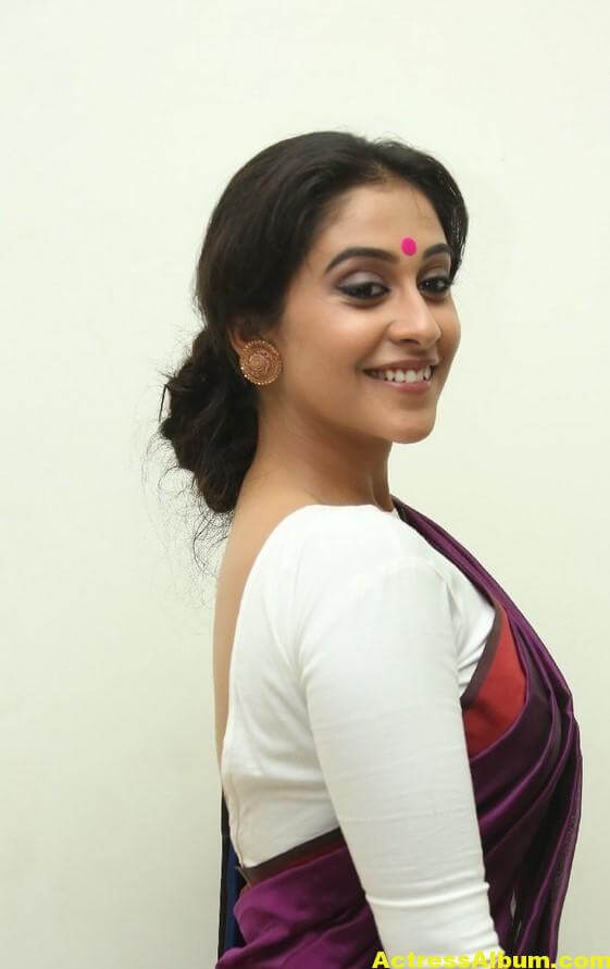 Regina Cassandra Latest Stills In Violet Saree 6
