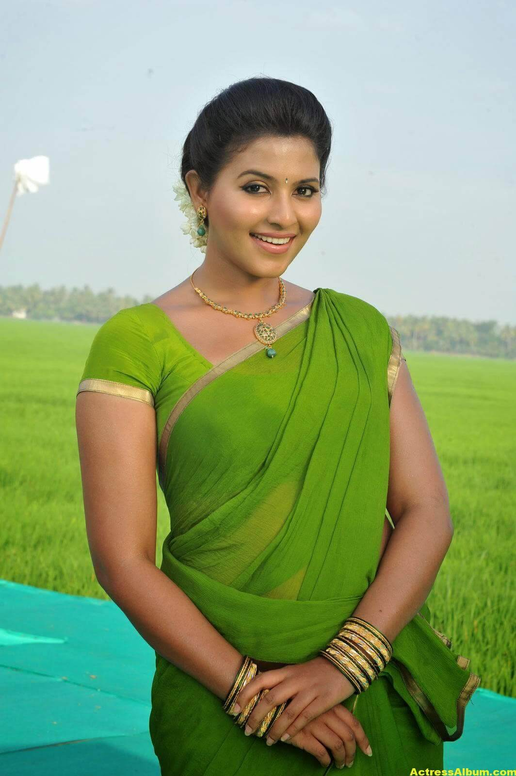 Anjali Cute Photos Stills In Spicy Green Saree 2