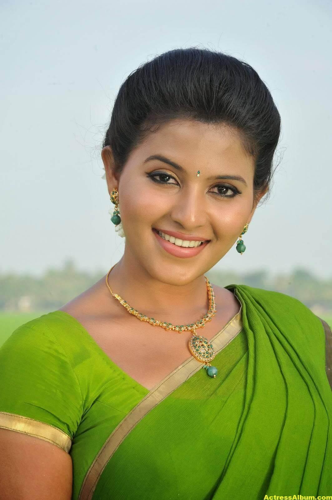 Anjali Cute Photos Stills In Spicy Green Saree 3
