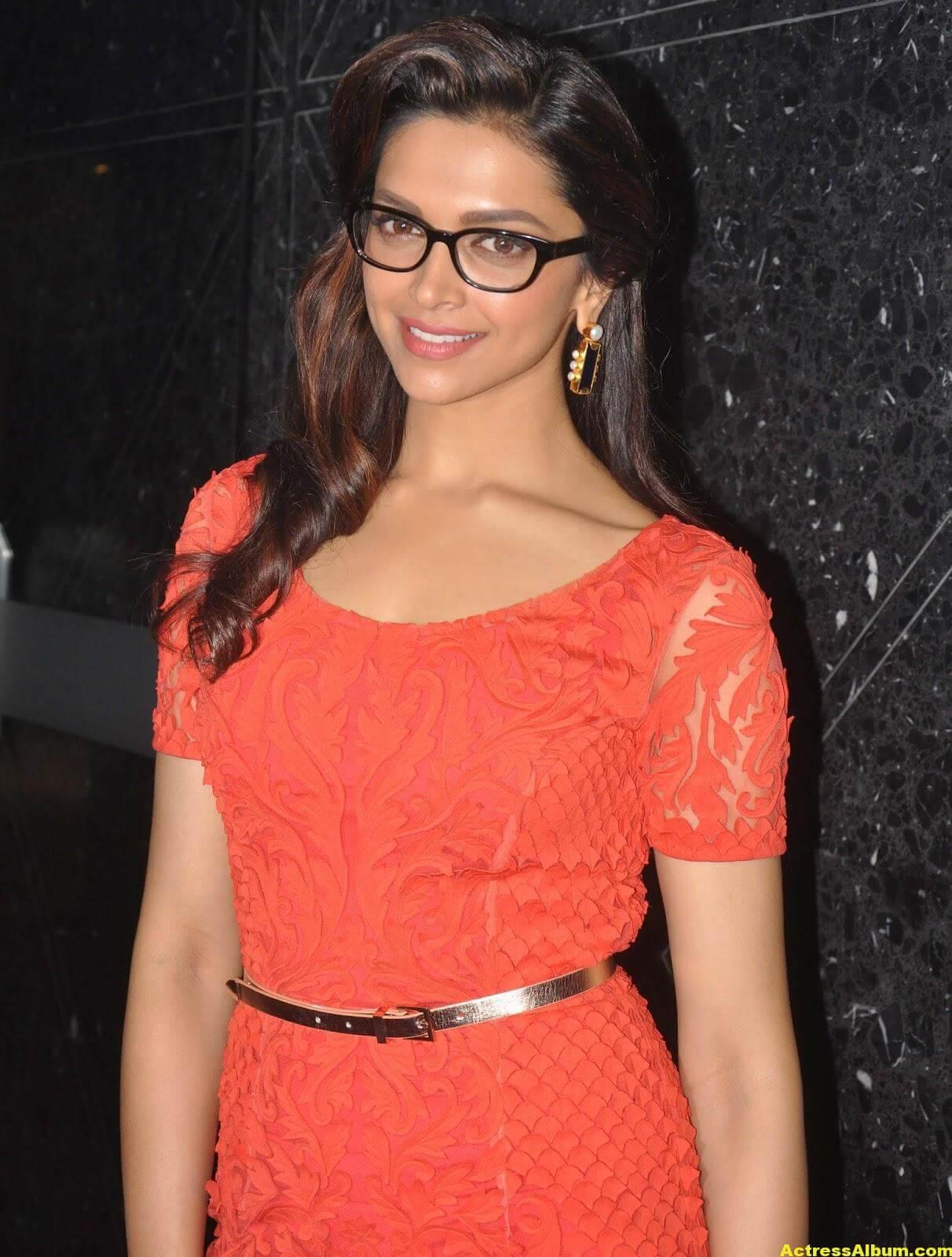 Deepika Padukone Photos In Orange Dress With Glass 1