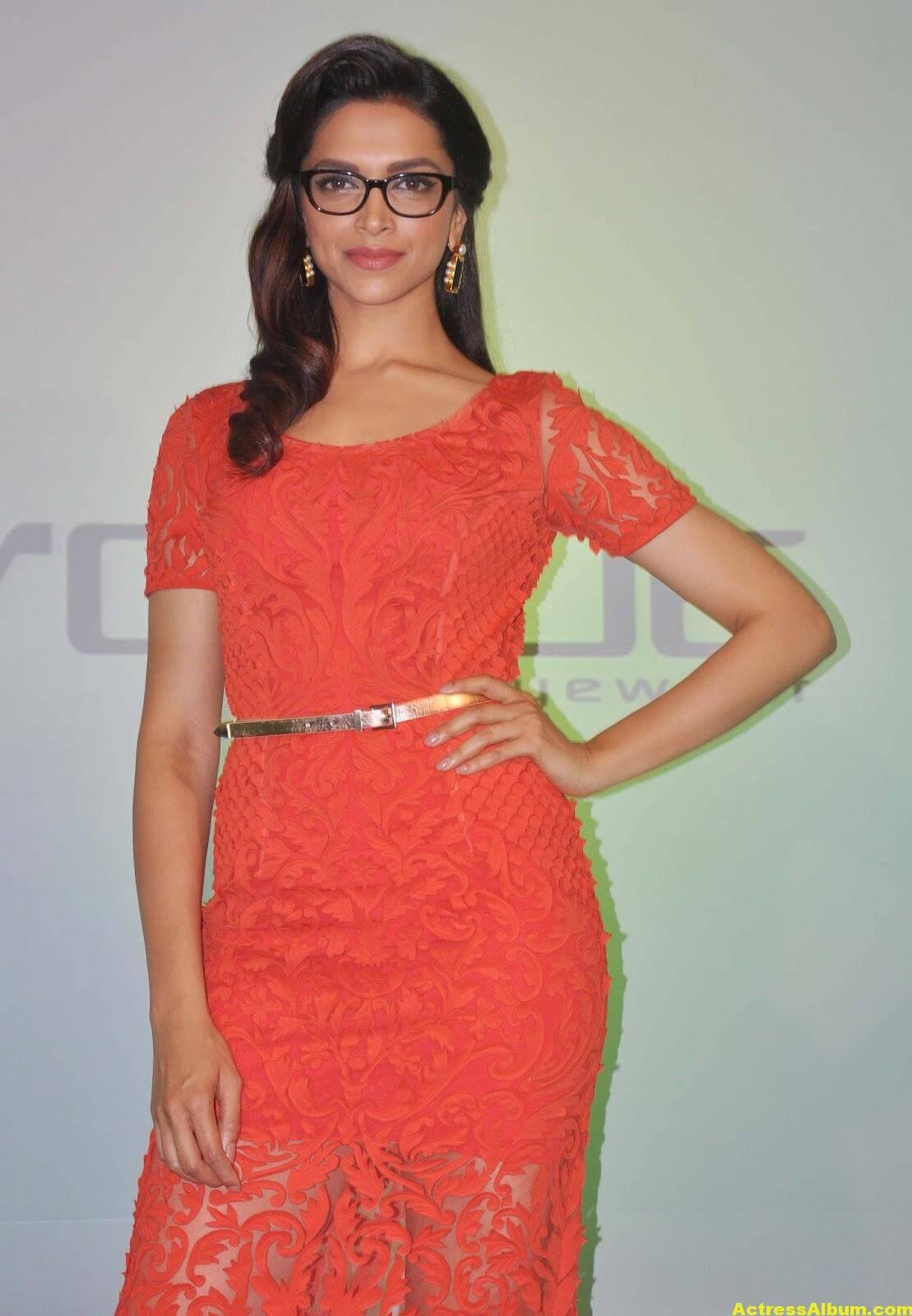 Deepika Padukone Photos In Orange Dress With Glass 2
