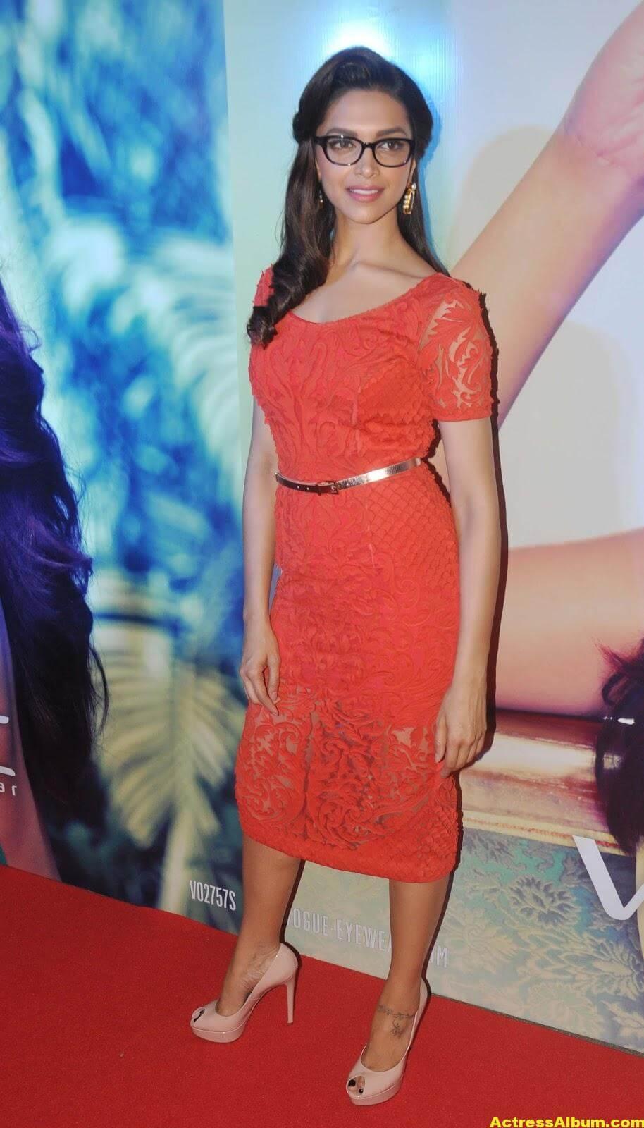 Deepika Padukone Photos In Orange Dress With Glass 3