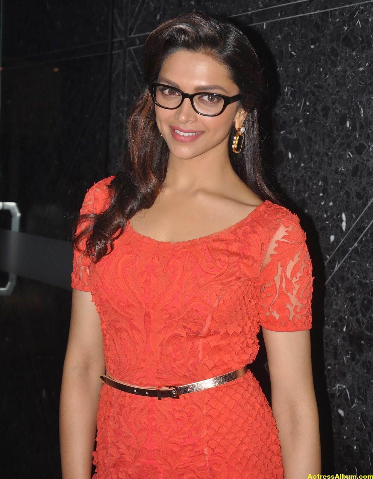 Deepika Padukone Photos In Orange Dress With Glass 4
