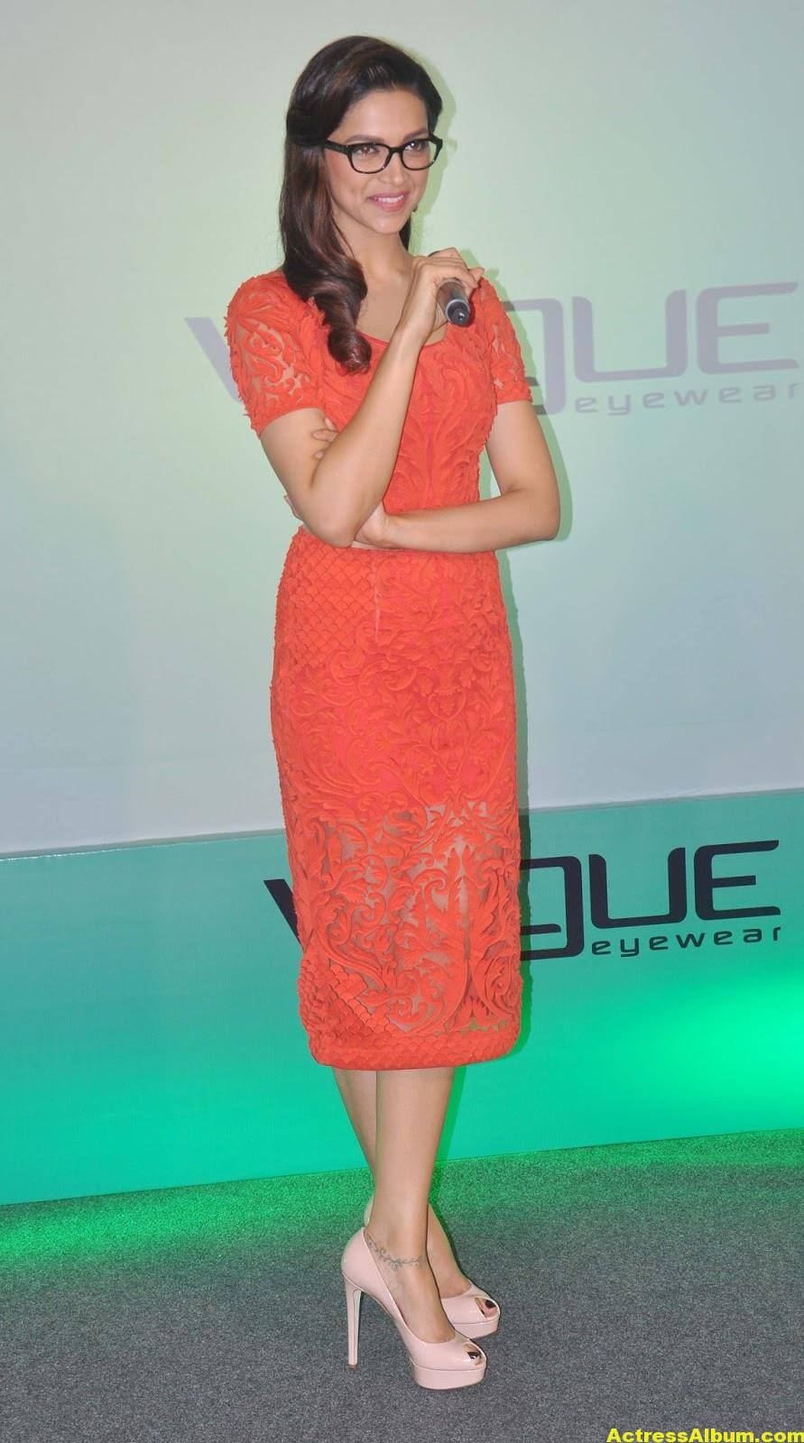 Deepika Padukone Photos In Orange Dress With Glass 5