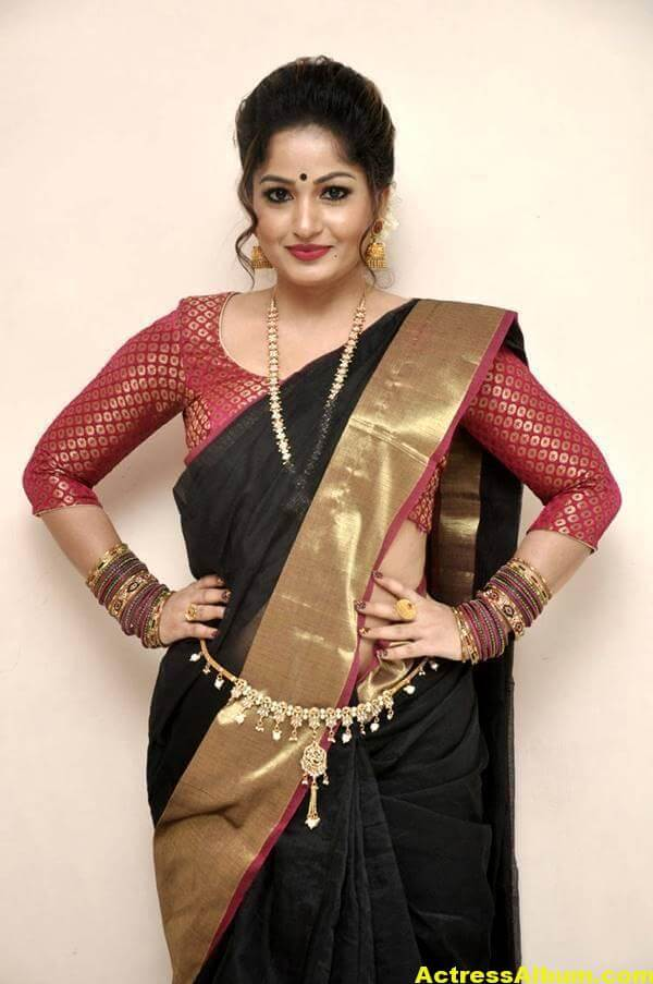 Madhavi Latha Navel Hip Show Stills In Black Saree 2