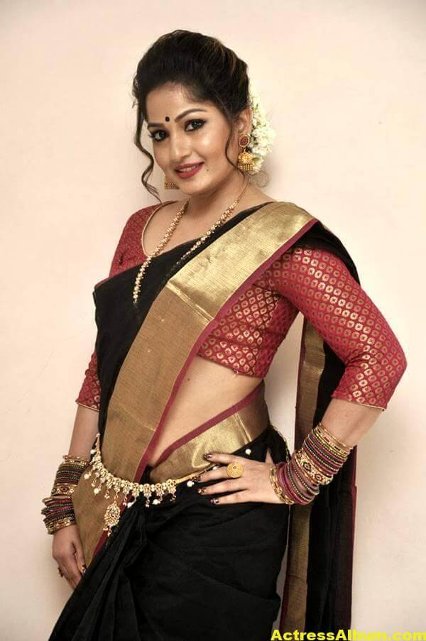 Madhavi Latha Navel Hip Show Stills In Black Saree 3