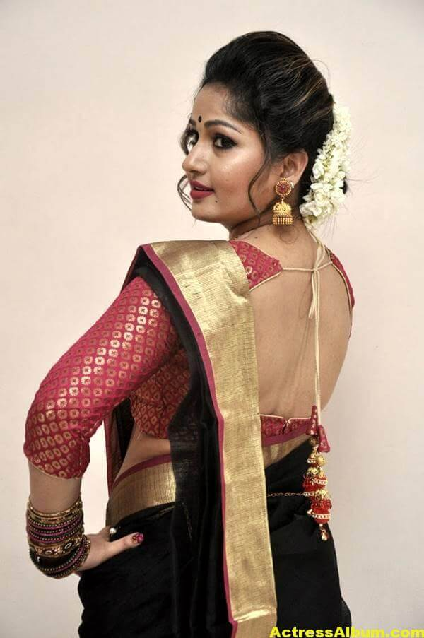 Madhavi Latha Navel Hip Show Stills In Black Saree 4