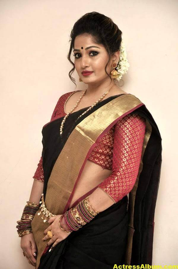 Madhavi Latha Navel Hip Show Stills In Black Saree 5