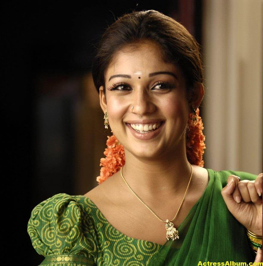 Nayantara Gorgeous Face Close Up Stills In Green Saree 0