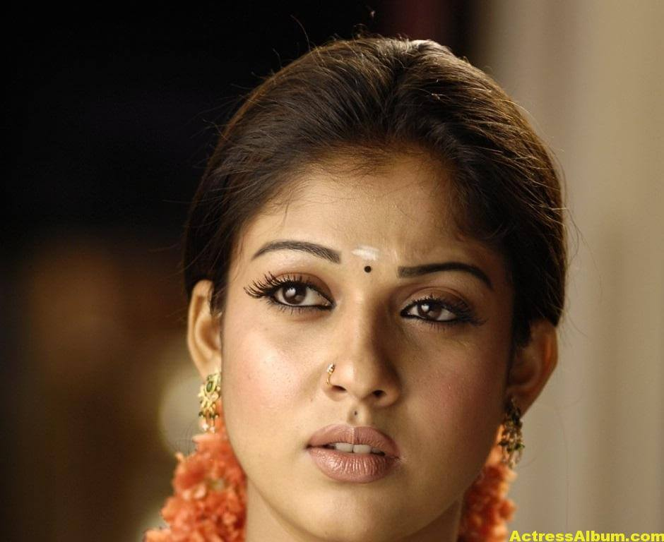 Nayantara Gorgeous Face Close Up Stills In Green Saree 1