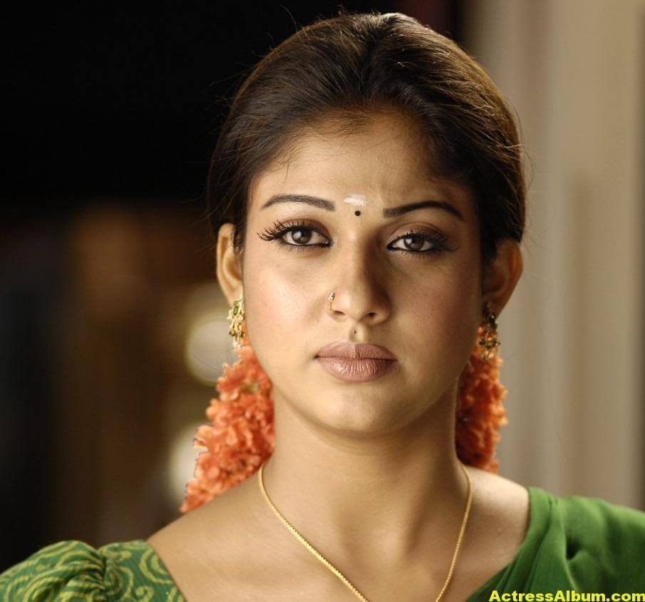 Nayantara Gorgeous Face Close Up Stills In Green Saree 2