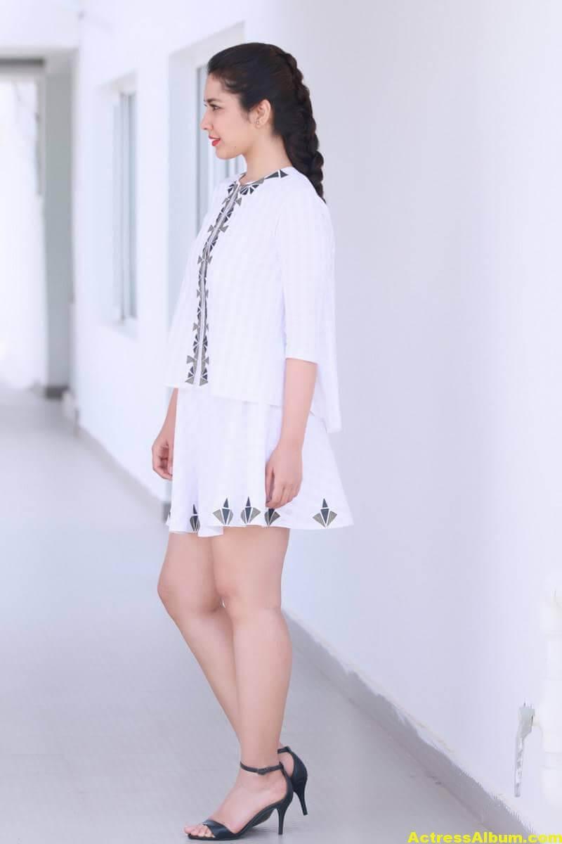 hot-rashi-khanna-legs-show-photo-shoot-in-white-skirt4